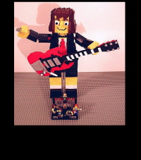 Angus Young Robot With Guitar and Stage